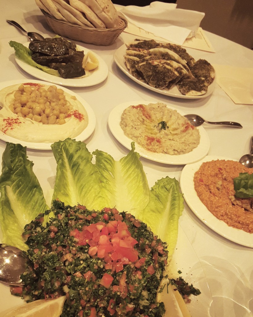 tabouleh, dips, grape leaves, zaatar pies